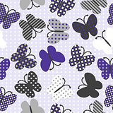 Seamless background with patterned butterflies