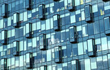 Facade of modern office building glass wall front view