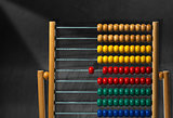 Colorful Wooden Abacus on a Blackboard