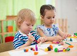 Kids or children creating arts and crafts in kindergarten