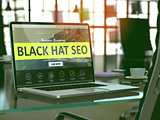 Laptop Screen with Black Hat Seo Concept.