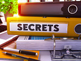 Yellow Office Folder with Inscription Secrets.
