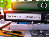 Procurement Management on Black Ring Binder.