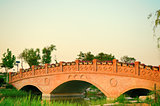 Sunset landscape with brick arch bridge