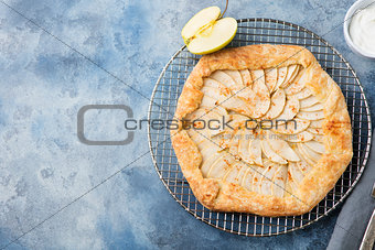 Apple galette, pie, tart with cinnamon Top view