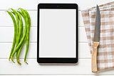 computer tablet and green beans