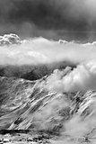 Black and white view on ski resort in mist