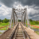 Railway bridge under the stormy skies.