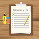 promotional media checklist on the clipboard with pencil