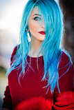 Portrait of beautiful young woman with blue hair