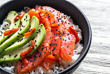 White rice with salmon and avocado