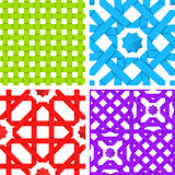 Seamless patterns set with colored crossed ribbons