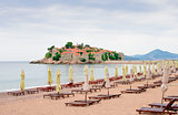 Luxury Sand Beach near Island and Resort Sveti Stefan, Montenegro. Balkans, Adriatic sea, Europe.