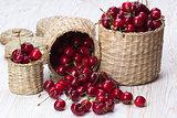 Cherry baskets on wooden background