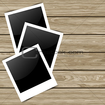 Blank photos on wood background