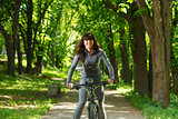 cyclist woman riding a bicycle in park
