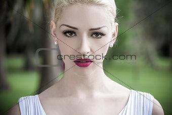 Beautiful Blond Woman in White Dress