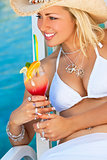 Beautiful Young Woman In Bikini Drinking Cocktail By The Sea