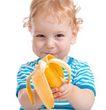 Happy kid or child eating banana