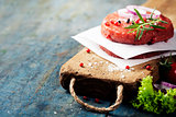 Raw Ground beef meat Burger steak cutlets with seasoning