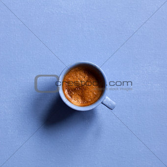 Aroma espresso cup on blue table