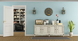 Retro living room with sideboard and open door