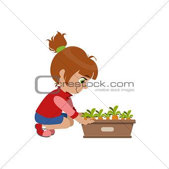 Little Girl Growing Carrots