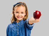Cute girl holding an apple