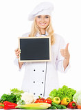 Woman cook with small blackboard