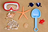 summer stuff on the sand of a beach