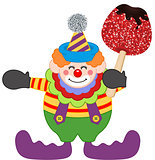 Clown holding candied apple