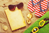 Summer beach holiday vacation accessories on sand surface