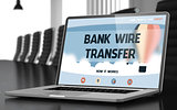 Laptop Screen with Bank Wire Transfer Concept.