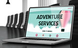 Adventure Services on Laptop in Conference Hall.