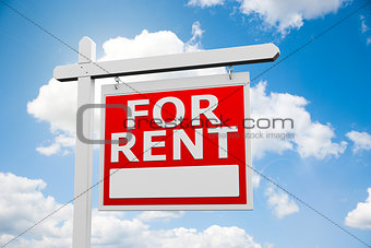 For Rent signpost on sky