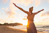 Free Happy Woman Enjoying Sunset on Sandy Beach