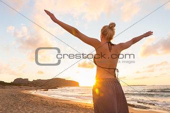 Free Happy Woman Enjoying Sunset on Sandy Beach