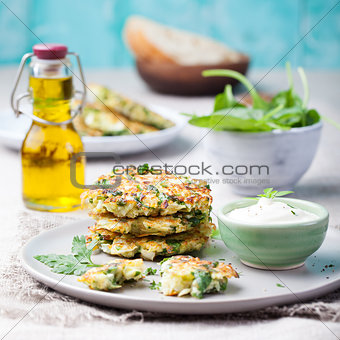Cabbage and spinach pancakes with yogurt dressing