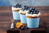Pumpkin cupcakes with cream cheese, blueberries