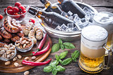 Grilled sausages with appetizers and mugs of beer