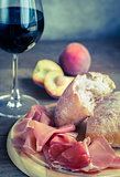 Red wine with prosciutto and ciabatta