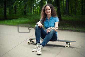 Beautiful young girl with longboard
