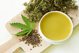 Cannabis healing ointment and marijuana leaf and seeds