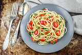 Pasta with cherry tomatoes and parsley