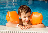 little cute boy in swimming pool close up smiling