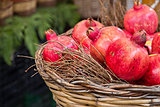 Fresh pomegranates are at the basket