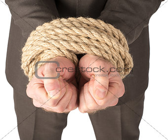 Businessman bound with rope