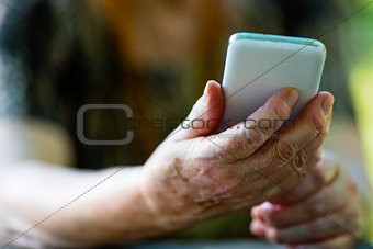 old woman holding a mobile phone