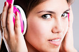 pink headphones and beautiful eyes of a woman