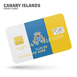 Credit card with Canary Islands flag background for bank, presentations and business. Isolated on white
